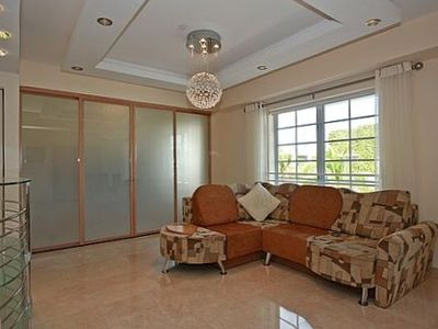 Living Room/ Den Area with glass doors closed
