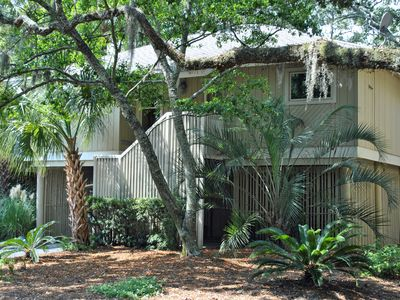 Summerwind Cottage nestled in the wooded area near hole two of both golf courses