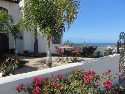 Front patio with view of ocean and mountains.
