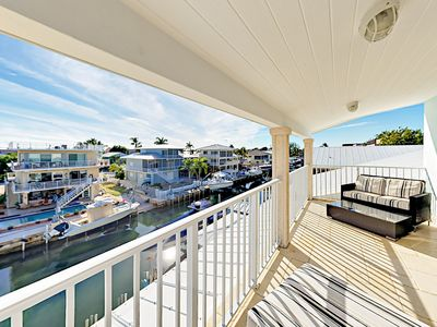 Balcony - The shared main-floor balcony offers plentiful seating and a birds-eye view of the canal.