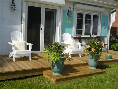 Waterside deck with gas grill.