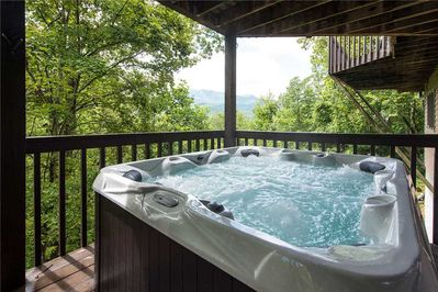 Revel in the hot tub day or night - After a day of hiking, golfing, or skiing, a soak in the hot tub is just the restorative treat you need. Or bask in the steamy water at night, under a canopy of stars—so romantic!