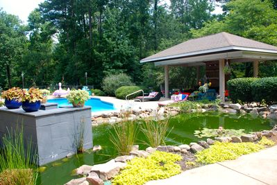 fish pond pool  waterfall pavilion w/outdoor fireplace