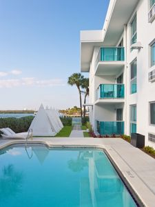 Photo for Walk to the beach from your spacious suite with private balcony.