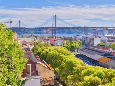 Photo for Bright apartment with terrace overlooking the Tagus River