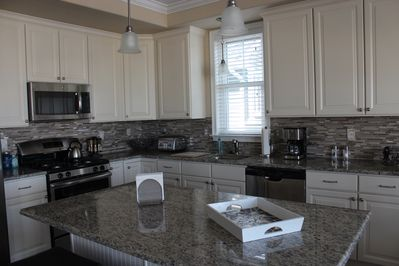 Large kitchen with granite counter tops and stainless steel appliances