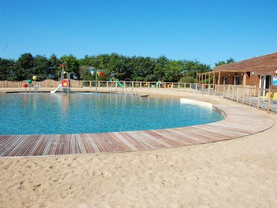 Photo for Homerez last minute deal - Amazing bungalow with pool access