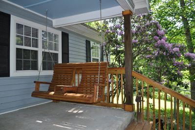 Enjoy the porch swing in the shade of the rhododendron.