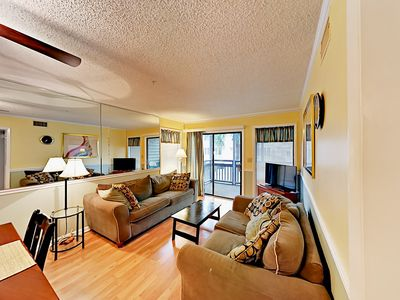 Photo for Updated 3BR Condo w/ Private Balcony & Pool - Walk to Beach