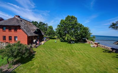 Photo for Holiday house on the cliff, apartment 3, 180 ° sea view, sauna, directly on the beach