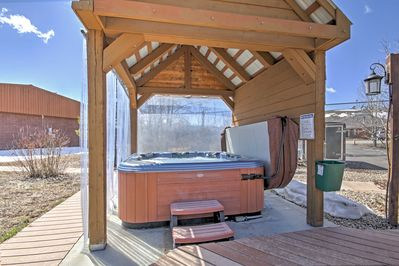 Take a dip in the Jacuzzi underneath the outdoor pergola.