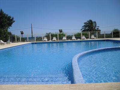 Photo for 2 Bedroom, 2 bathroom beachfront penthouse with stunning sea views. Free wifi