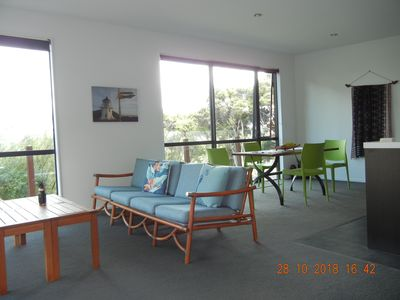 Photo for Holiday house with sea views over tall totara.