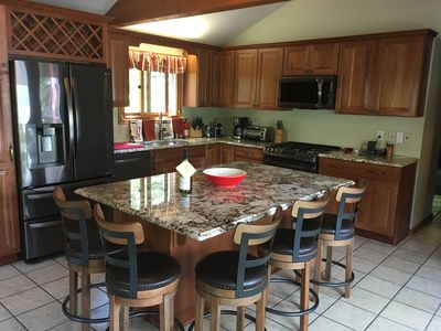 Remodeled kitchen with granite counters and center island with seating for 5