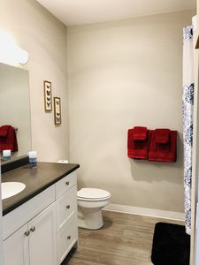 Bathroom with soaking tub and washer and dryer