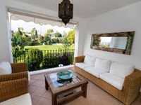 Peaceful situation overlooking golf course but near restaurants and shops