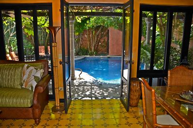 The living area opens to the private pool...a true oasis!