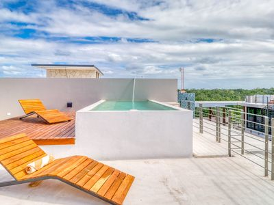 Photo for Secluded penthouse in the jungle of Tulum w/ views from private rooftop pool!