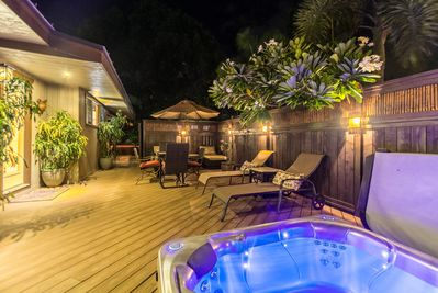 Soak in the hot tub by moonlight.