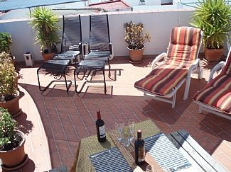 Photo for Modern apartment with air con & WiFi. Private roof terrace with great sea views.
