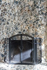 Indoor fire place clad with rock from the river beach.