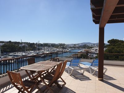 Photo for Luxurious two bedroom penthouse on cala dor marina sea front with pool.
