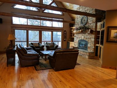 Living room with fireplace and entertainment center.