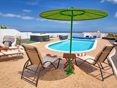 Photo for Delightful child friendly 3 bed villa with fabulous sea views ,hot tub & air con