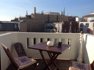 Photo for Little paradise with terrace overlooking Parisian rooftops