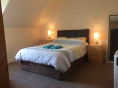 North facing double room with a glimpse of the Perthshire hills and Kenmore St.