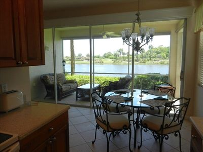 Eat in kitchen with lanai beyond with lake and golf course view.