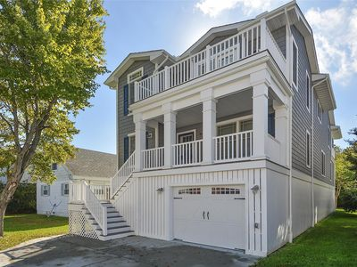 Photo for FREE DAILY ACTIVITIES!!  This amazing 5 bedroom with den, 4.5 bath home is conveniently located in the heart of downtown Bethany Beach just steps from the beach,