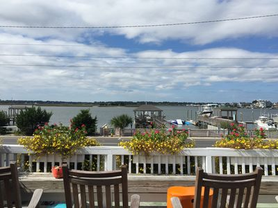 Photo for Beautifully Decorated Cottage! Steps from the Beach and Private Dock!