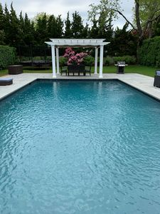 Gunite custom pool with landscaping and covered dining. Viking outdoor grill