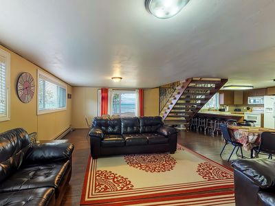 Photo for NEW LISTING! Lakefront east side home on private beach with a large grassy yard!