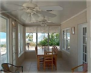 Large dining table for meals overlooking Gulf!
