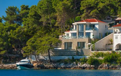 Photo for Amazing luxury villa with seafront and own mooring for boats