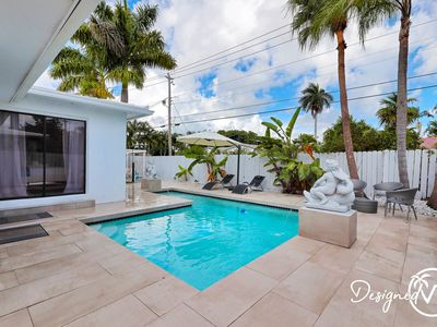 Photo for Modern 4BR Retreat w/ Heated Pool-Close to Beach