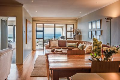 The spacious and well-appointed open-plan living area with beautiful ocean views