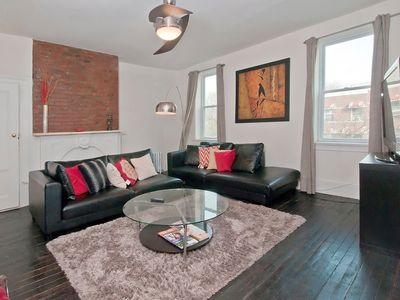 Exposed brick with sealed fireplace for urban yet cozy feel.