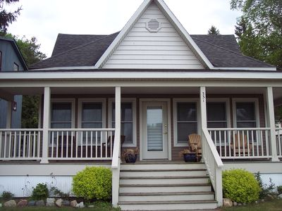 Wrap around porch is perfect to enjoy the lake and marina views