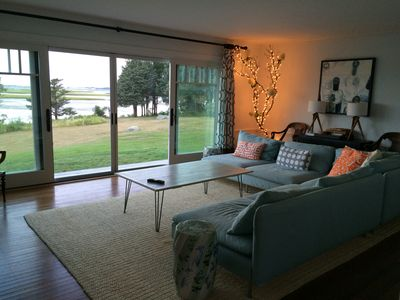 Blue sectional, orange pillows, decorative lights and a picture perfect view!