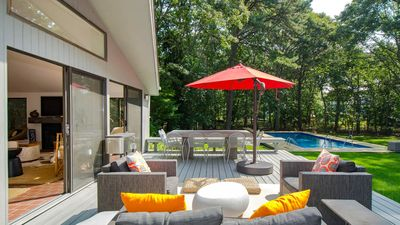 Photo for Impeccable Indoor/Outdoor Living on a Half-Acre in East Hampton w/ Wraparound Deck, Heated Pool