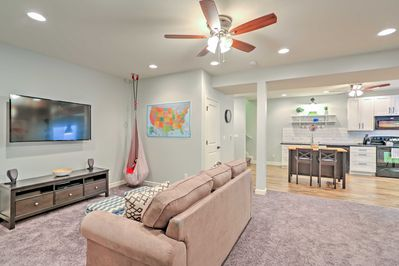 The living room  boasts a 50-inch Smart TV and brand new sofa.