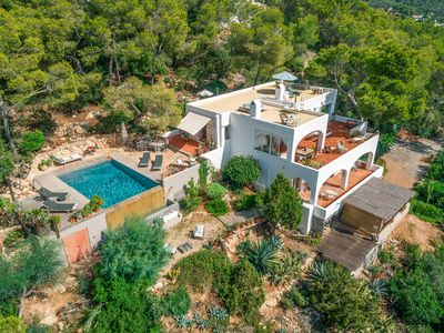 Photo for 5 bedrooms, stunning sea views, Es Cubells, infinity pool
