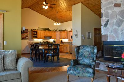 Spacious and open dining/ kitchen and living areas with beautiful cedar  ceiling
