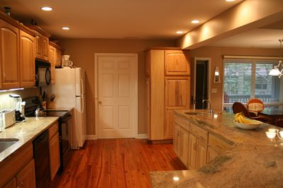 Spacious deluxe kitchen with breakfast bar