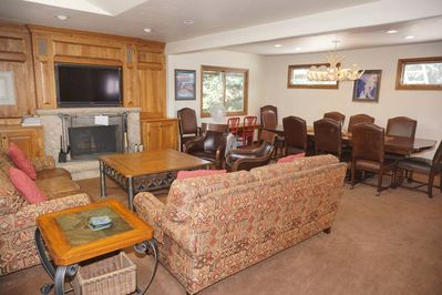 Living Room/Dining Room with WoodBurning Fireplace and large screen TV