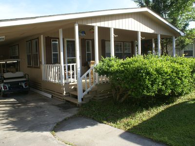 Photo for 3 Bedrms 2 baths across  street from outdoor pool 2 min golf cart ride to beach!