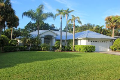 Lushly landscaped front yard of this vacation home.